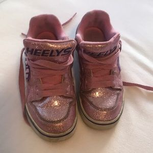 Heely's sneakers with wheels.